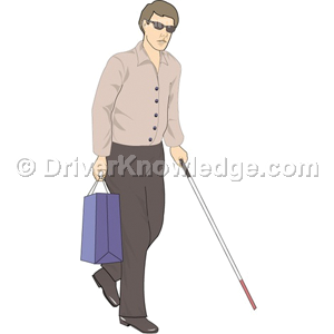 pedestrian using a white cane