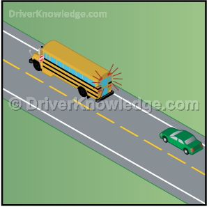 school bus is stopped on a 2 way undivided road with flashing red lights
