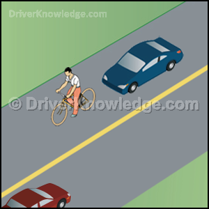 best strategy to pass the bicyclist safely