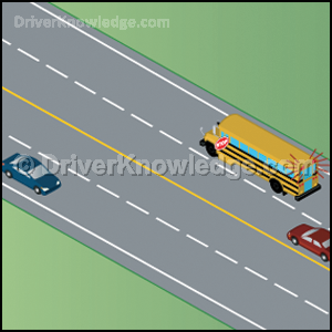 school bus stopped on a four lane road