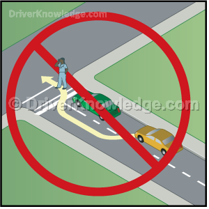 vehicle in front of you is stopped at a crosswalk